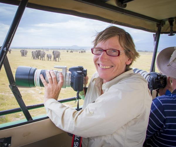 photo tour guest with elephants
